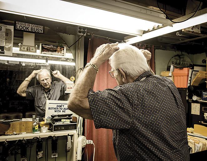 Del Puschert combs his hair