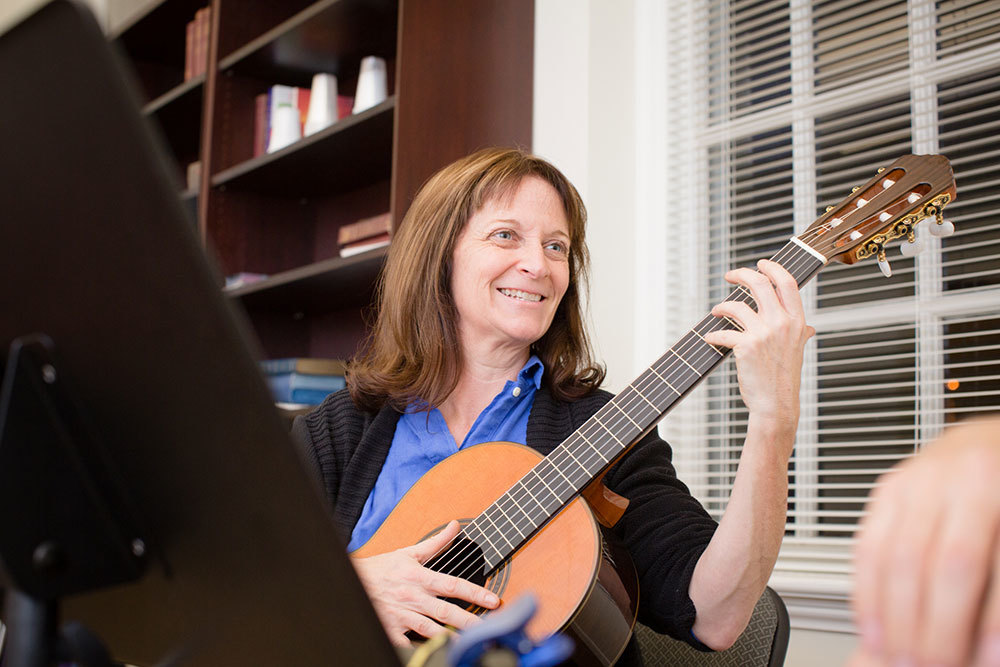 An adult guitar student at Baltimore School of Music.