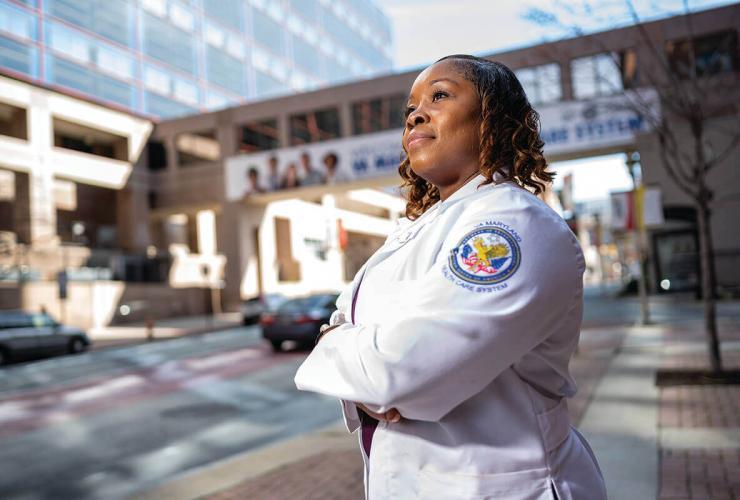 Nurse Lt. MeShondra Collins outside a hospital.