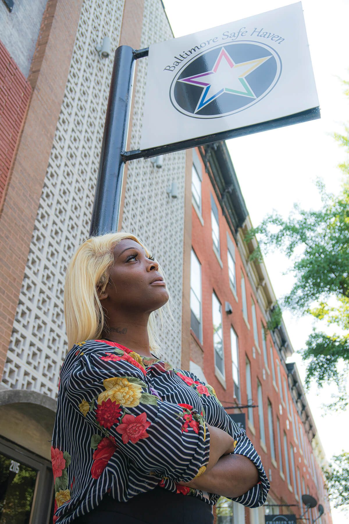 A photo of Iya Dammons in front of Baltimore Safe Haven in Charles Village.