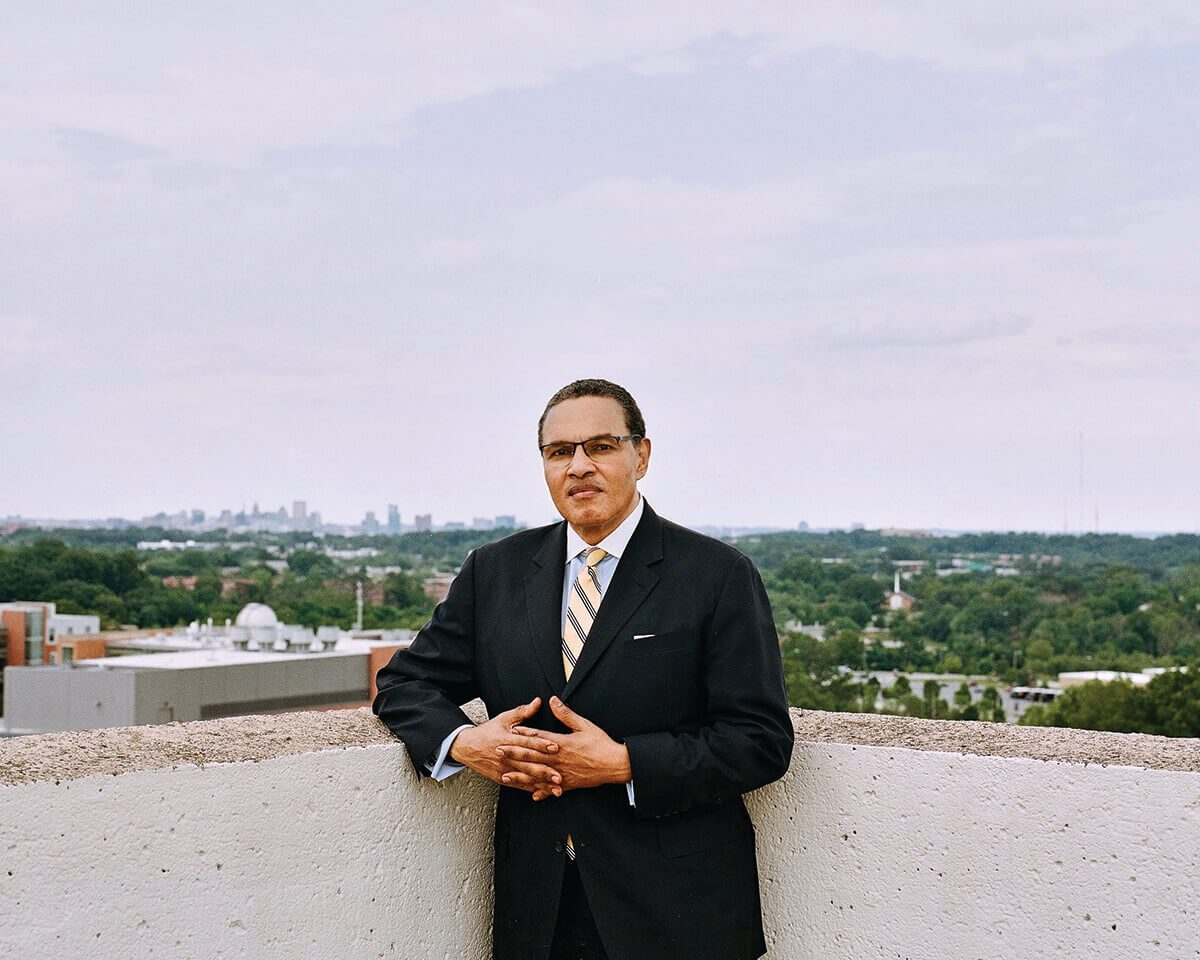 Freeman Hrabowski stands on the roof of the administration building at UMBC.