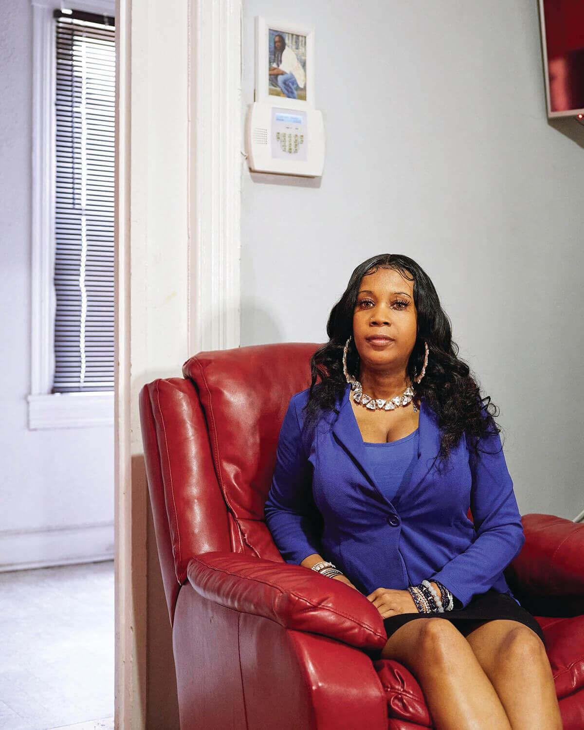 Tawanda Jones at her Home under a Photograph of Her brother.